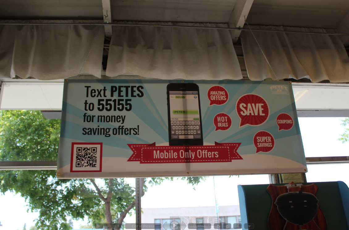 This in-store poster combines two options for promoting mobile wallet content. They used both a text code as well as a QR code to allow people to download the mobile wallet content.